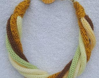 Totally unique handmade multi coloured and multi strand knitted necklace in shades of yellow, brown and green.