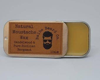 Natural Moustache Wax in slider tin. Made with beeswax and natural oils, gives a medium hold