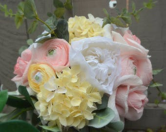 Pastel pink and yellow paper wedding bouquet, with white David Austin roses and greenery.