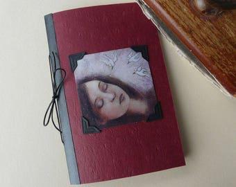 Burgundy journal with girl sleeping birds illustration