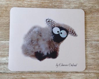 Mouse pad with sheep on pink background