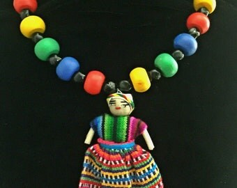Multi-colored beaded necklace w/doll pendant