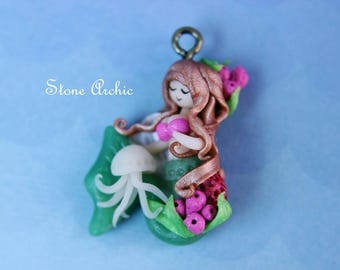 Little mermaid with glowing jellyfish charm