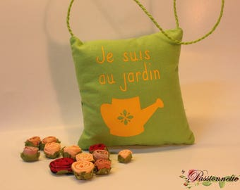"""Small pillow to hang on the door with the message """"I'm in the garden"""""""