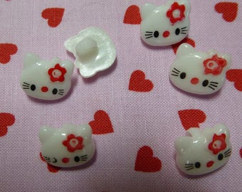 White cat with bow red buttons