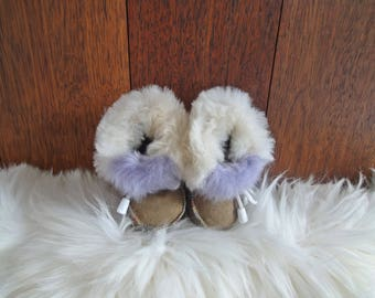 Sheepskin slippers for kids. Genuine leather and natural fur inside.