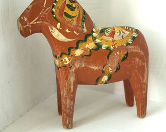 Swedish wooden Dala Horse painted red with traditional 'kurbits' decorative detail