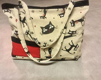 Purse black cat on a beige background