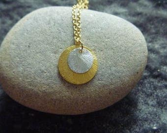 round gold and silver necklace. Sun and moon