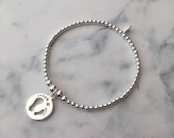 Sterling Silver stretch bracelet with Footprints charm