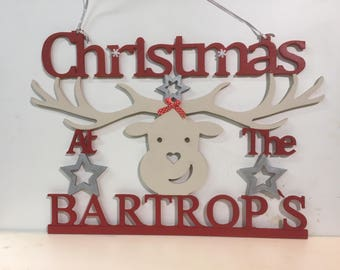 Christmas mdf at the surname signs hanging