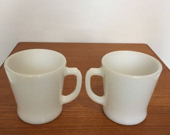 Two white mid century Anchor Hocking Fire-king mugs