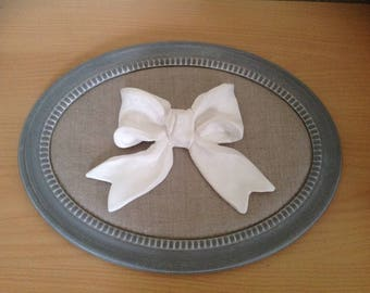 Oval wooden frame with linen fabric and a white knot