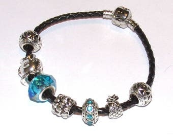 """Pandora"" style black leather bracelet with turquoise charms"
