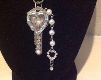 Key necklace with heart of rhinestones and pearl accents. Silver  15 inch chain. One of a kind.