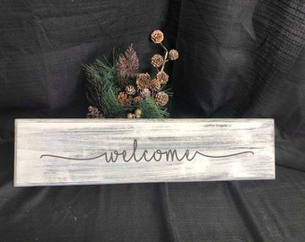 Engraved Welcome wooden sign.  Can personalize.  Painted, sanded, and engraved with black painted lettering.