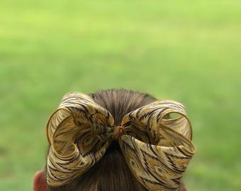 5.5 inch brown Aztec print bow
