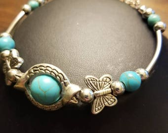 Turquoise beads and butterfly bracelet