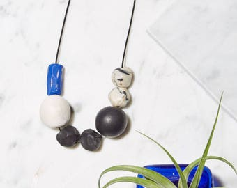 Black, White, and Blue Beaded Clay Necklace