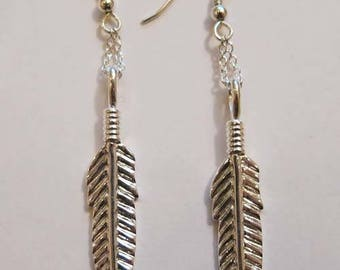 Silver patterned Indian feather earrings