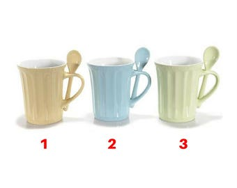 A colored ceramic mug with spoon integrated model 1