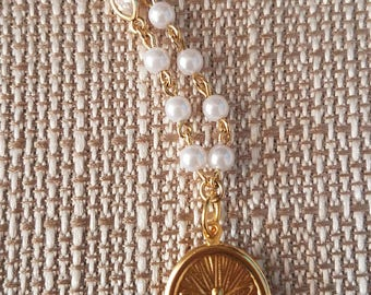 The Holy Spirit with necklace of pearls