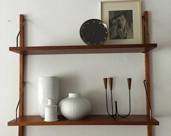 Poul Cadovius. Cado | wall unit | shelf | Bookshelf | 60s | Royal system. Danish modern. Teak