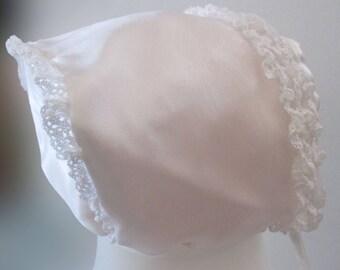 Delicate white cotton and organza bonnet