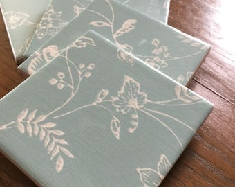 Hand-finished turquoise floral coaster