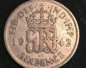 A 1942 King & Emperor George VI .500 silver English sixpence coin