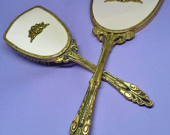 Vintage 1940s vanity set of mirror and brush, brass and satin