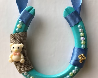 Real decorated lucky horseshoe for baby