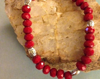 Silver ladybugs and red glass bead bracelet