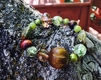 Handmade earthtone beaded bracelet, with wood and glass beads from the around the world.