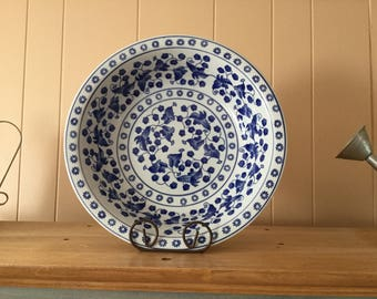 Large vintage blue and white bowl with flowers and leaves