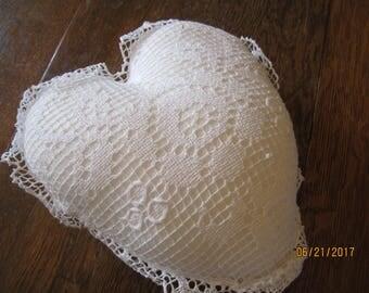 Crochet heart pillow cover and insert.