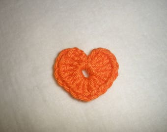Set of six small crochet hearts