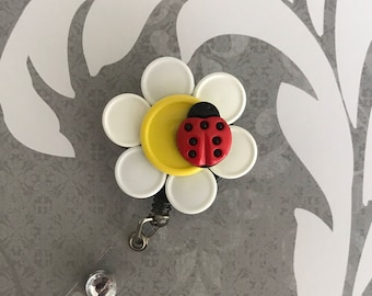 Flower with lady bug badge reel 20% OFF
