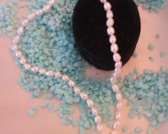 "20"" white freshwater rice pearls"