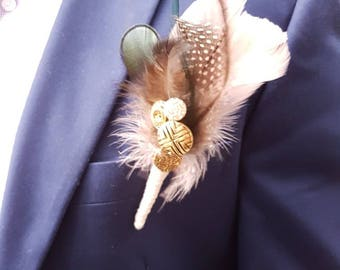 Beautiful wedding feather boutonniere, made by Glamour bouquets UK.