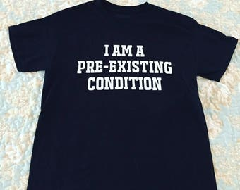 Healthcare Protest T-Shirt - I am a Pre-Existing Condition