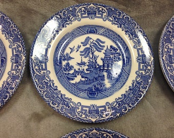 Set of six traditional Willow Pattern side plates