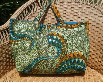 Tote bag was fabric printed African fantasy in shades of Blues, Greens, oranges.