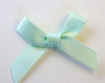 25 x 7mm Satin ribbon bow: Mint - 02355