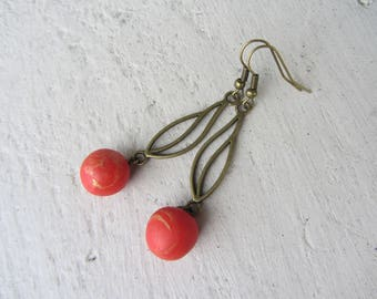 Earrings dangle, stylized metal leaf bronze and polymer red marbled with gold ball charm