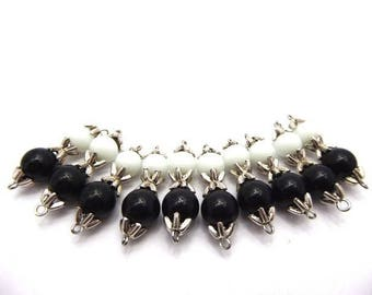 10 black and white glass beads mounted with bead caps