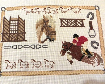 Hand embroidered canvas: riding, horse, rider and various patterns.