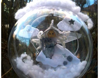 White Angel/fairy and her gray cat in a transparent ball