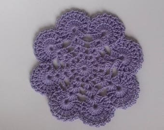 purple colored crochet doily