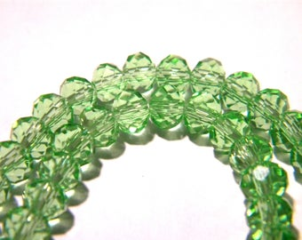 """46 beads 6 mm x 4 mm glass """"Austrian Crystal"""" - pale green - faceted bead faceted - F136"""